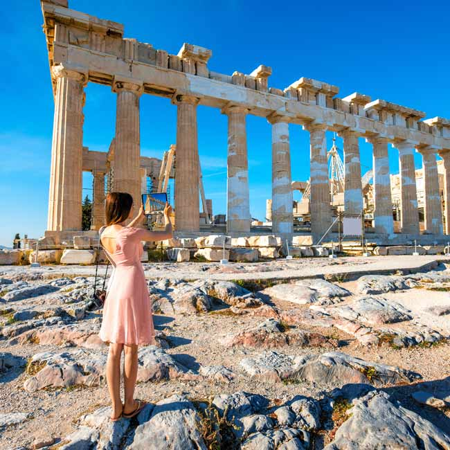 Young woman at the Acropolis in Athens - Luxury Travel Services by Travelive