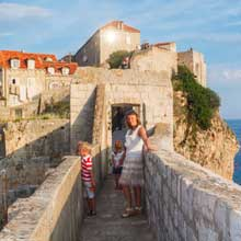 Family walking on Dubrovnik walls – Vacation Packages in Croatia, Travelive