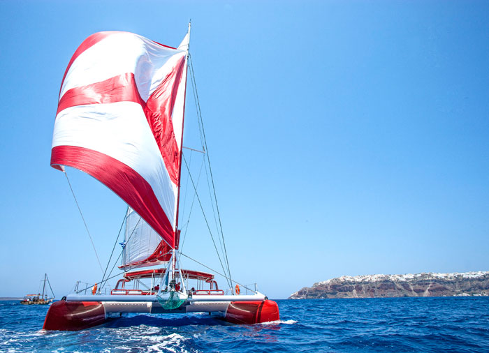 Catamaran cruise – tour Santorini island with Travelive' s Greek island honeymoon packages
