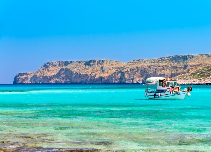 Fishing boat – Balos Beach, Crete honeymoon exploration with Travelive, luxury travel agency