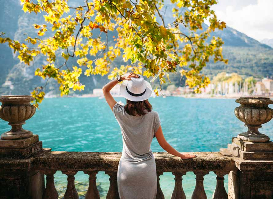 Woman Overlooking Lake Como – Luxury Travel to Italy by Travelive