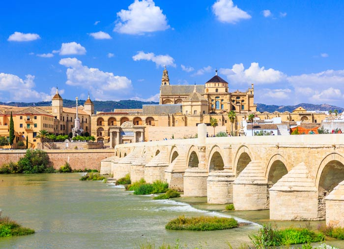 Roman Bridge – Mosque Cathedral, Cordoba Granada tours with Travelive