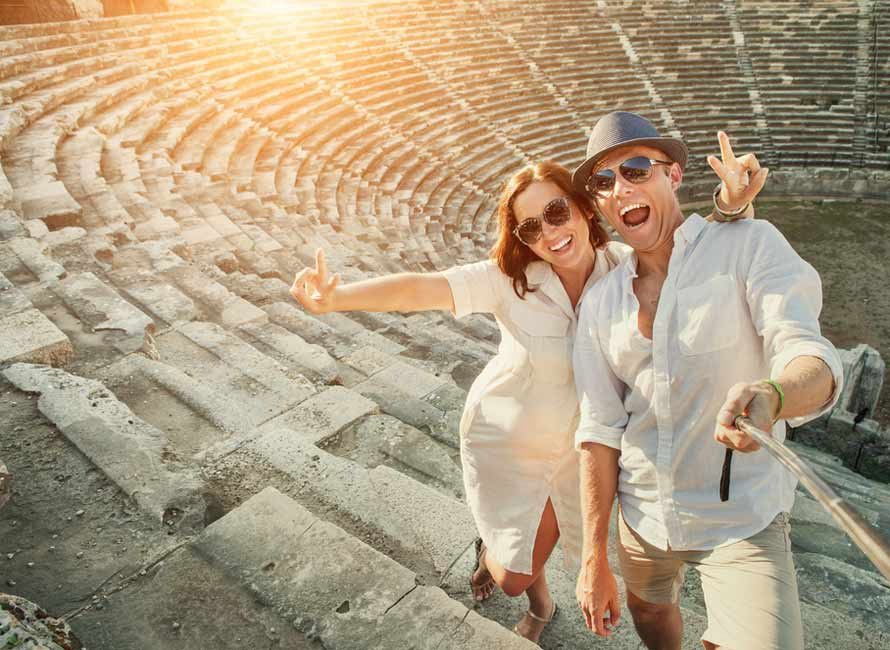 Couple at Amphitheater in Turkey, Luxury Honeymoon Packages, Travel to Turkey